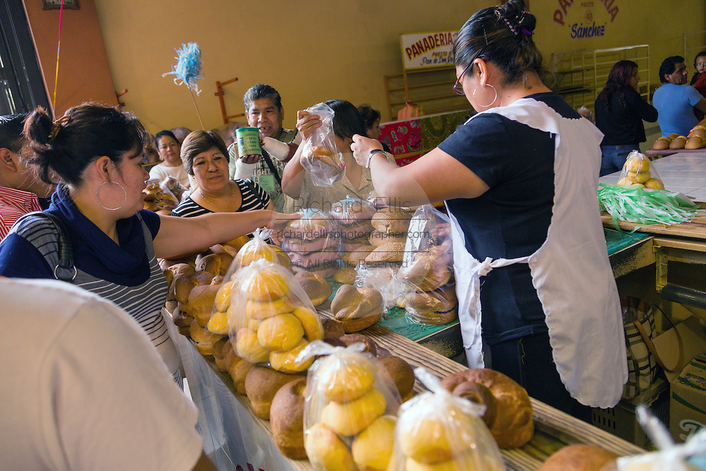 Fresh bread and rolls at the Sunday market in Tlacolula de Matamoros, Mexico. The regional street market draws thousands of sellers and shoppers from throughout the Valles Centrales de Oaxaca.