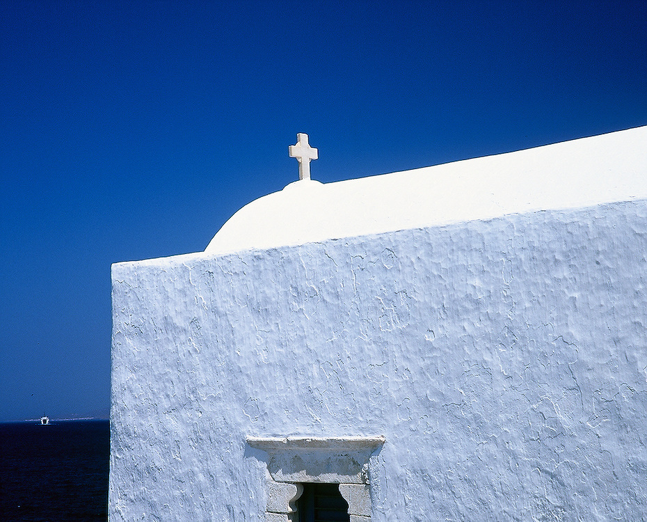 White church against blue sky in Mykonos, Greece