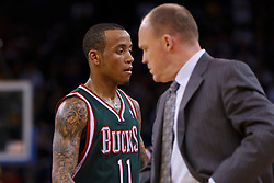 Mar 16, 2012; Oakland, CA, USA; Milwaukee Bucks point guard Monta Ellis (11) walks past head coach Scott Skiles during a stoppage in play against the Golden State Warriors during the third quarter at Oracle Arena. Milwaukee defeated Golden State 120-98. Mandatory Credit: Jason O. Watson-US PRESSWIRE