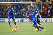 AFC Wimbledon striker Andy Barcham (17) dribbling and taking on Wigan Athletic forward Will Grigg (9) during the EFL Sky Bet League 1 match between AFC Wimbledon and Wigan Athletic at the Cherry Red Records Stadium, Kingston, England on 16 December 2017. Photo by Matthew Redman.