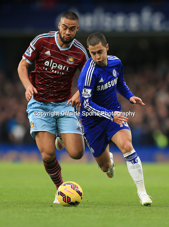 26 December 2014 - Barclays Premier League - Chelsea v West Ham - Eden Hazard of Chelsea tangles with Winston Reid of West Ham - Photo: Marc Atkins / Offside.