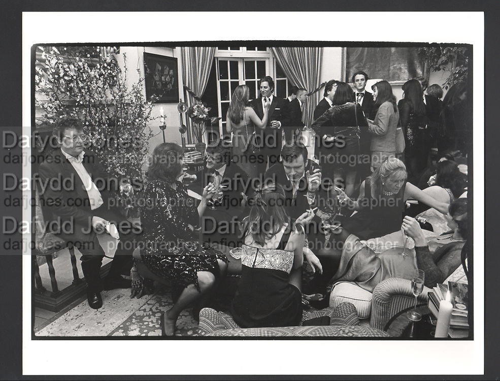 David Litchfield surveys the scene during a surprise birthday party given for Baron Bentinck. The Vale. London 26 March 1997.Exhibition in a Box