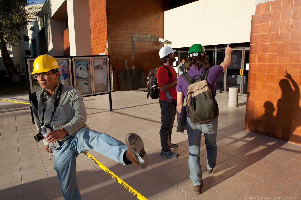 Dr. Benson Shing crosses a safety cordon on the campus of the Universidad Autónoma de Baja California. A group of researchers led by Dr. Benson Shing, Vice Chair of the Department of Structural Engineering at the University of California, San Diego, inspected the earthquake damage in Mexicali, Mexico, April 7, 2010. A 7.2 magnitude earthquake in Baja California on Easter Sunday was felt as far away as Los Angeles.