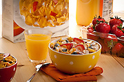 Breakfast scene with Cereal,fruits and Orange juice,strawberries
