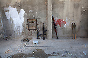 AK-47s and rocket propelled grenede launchers are seen against a wall  as Free Syrian Army fighters fight against govermment  forces  in Karm al-Tarib, near Aleppo's international airport.Aleppo, Syria August 17,2012. (Photo by Heidi Levine/Sipa Press).