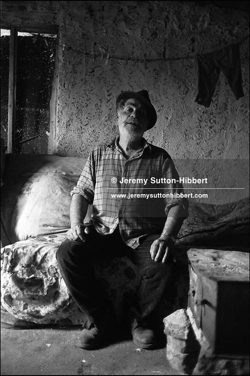 GOGU MIHAI. SINTESTI, ROMANIA, MAY 1997..©JEREMY SUTTON-HIBBERT 2000..TEL./FAX. +44-141-649-2912..TEL. +44-7831-138817.