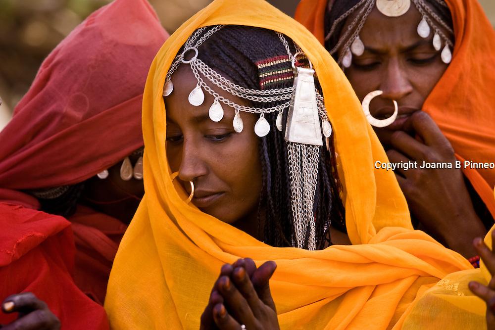 Shanabla woman sings at a wedding celebration near El Obeid, Sudan. A nomadic tribe they raise camels.