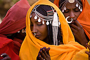 Shanabla woman sings at a wedding celebration near El Obeid, Sudan. A nomadic tribe they raise camels.