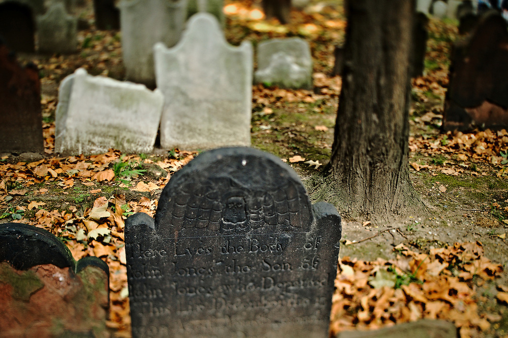 Weathered gravestones in cemetery behind St. Paul's Chapel, lower Manhattan, New York, NY, US