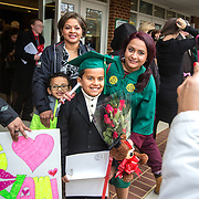 FAIRFAX, VA -DEC21: Emerita Ayala, 23, poses for pictures with her son Dominic, 8 (center),  brother Christopher, 6, and mom Zenayda, 44, after her graduation from George Mason University, December 21, 2016, in Fairfax, Virginia, where she earned her bachelors degree. Emerita started as a teenage mom at 18, with her 3-year-old son at community college. She got help through a nonprofit called Generation Hope that provides scholarships and mentoring to teenage moms. (Photo by Evelyn Hockstein/For The Washington Post)