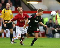 Photo: Dave Linney.<br />Walsall v Milton Keynes Dons. Coca Cola League 2. 28/10/2006. Walsll's Dean Keates(L) keeps a close watch on   Gareth Edds