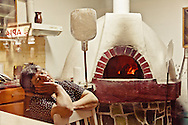 Baking bread from 4am, this woman takes a little siesta, in the village of Paleohora. Crete Greece.