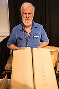 Gordon Carson of Mountain Voice Soundwoods in Valemont, BC, Canada, with samples of spruce. Wood for musical instruments is split from the tree trunk, and adjoining planks are numbered so the grain will be bookmatched in the finished instrument.