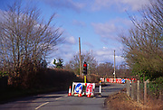 A07XG3 Red traffic light at roadworks on country road