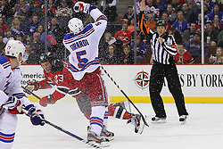 Jan 31; Newark, NJ, USA; New York Rangers defenseman Dan Girardi (5) is called for taking down New Jersey Devils right wing David Clarkson (23) during the second period at the Prudential Center.