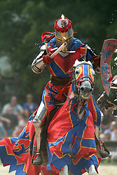 A knight from the Bristol Renaissance Faire takes a shield-shattering hit during the Royal Joust in Kenosha, Wisconsin.