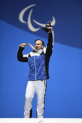 March 12, 2018 - Pyeongchang, South Korea - Gold medalist Matti Suur-Hamari of Finland celebrates during a medal ceremony for Men's Snowboard Cross Monday, March 12, 2018 at the Medals Plaza for the 2018 Pyeongchang Winter Paralympic Games. Photo by Mark Reis (Credit Image: © Mark Reis via ZUMA Wire)