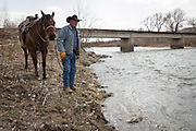 CREDIT: Steven St. John for The Wall Street Journal<br /> &quot;ANIMAS&quot;<br /> <br /> Rancher Lin Blancett, whose cows had to be evacuated because of the Gold King Mine spill, stands along the Animas River on Tuesday, March 22, 2016