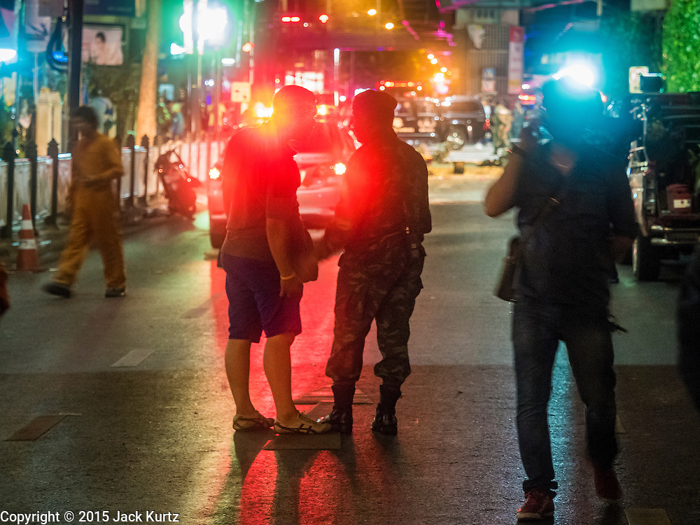 17 AUGUST 2015 - BANGKOK, THAILAND: Thai police and bomb squad officers at the scene of an explosion in central Bangkok Monday. An explosion at Erawan Shrine, a popular tourist attraction and important religious shrine, in the heart of the Bangkok shopping district killed at least 19 people and injured more than 120 others, mostly foreign tourists, during the Monday evening rush hour. Twelve of the dead were killed at the scene. Thai police said an Improvised Explosive Device (IED) was detonated at 18.55. Police said the bomb was made of more than six pounds of TNT stuffed in a pipe and wrapped with white cloth. Its destructive radius was estimated at 100 meters. The Bangkok government announced that public schools would be closed Tuesday as a precaution.         PHOTO BY JACK KURTZ