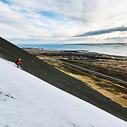 David hiking to ski a line outside Reykjavik, Iceland