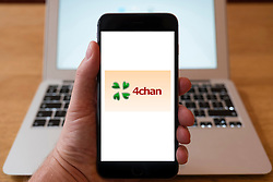 Using iPhone smartphone to display logo of 4Chan online image based bulletin board