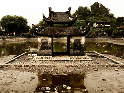 Ancient water-puppet show stage built in the middle of the pond facing Thay Pagoda, Hanoi, Vietnam, Southeast Asia