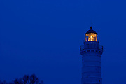 Cana Island Lighthouse at sunset in Door County Wisconsin.  (Photo by Mike Roemer)
