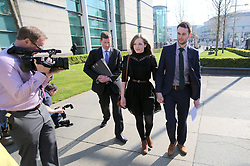 "© Licensed to London News Pictures. 9/05/2016. Belfast, Northern Ireland, UK.  Amy and Daniel McArthur from Ashers Baking Company arrive at Belfast High Court for the start Appeal hearing over gay marriage cake row with Ashers Baking Company. The legal appeal by Ashers Baking Company in the controversial 'gay cake' case is to be heard over two days. In May last year a judge at Belfast County Court ruled that the bakery had acted unlawfully. The court ordered Ashers to pay £500 damages after Judge Isobel Brownlie said the customer had been treated ""less favourably"" contrary to the law and the bakery had breached political and sexual orientation discrimination regulations. But the McArthur family who own and run Ashers decided to challenge the ruling following consultations with their legal advisors. The family has been given the full support of The Christian Institute, which has funded their defence costs. The legal case followed a decision in May 2014 by Ashers to decline an order placed at its Belfast store by a gay rights activist who asked for a cake featuring the Sesame Street puppets, Bert and Ernie, and the campaign slogan, 'Support Gay Marriage'. The customer also wanted the cake to feature the logo of a Belfast-based campaign group QueerSpace. Ashers, owned by Colin and Karen McArthur, refused to make the cake because it carried a message contrary to the family's firmly-held Christian beliefs. They were supported by their son Daniel, the General Manager of the company. But the Equality Commission for Northern Ireland (ECNI) launched a civil action against the family-run bakery, claiming its actions violated equality laws in Northern Ireland and alleging discrimination under two anti-discrimination statutes – The Equality Act (Sexual Orientation) Regulations (NI) 2006 and The Fair Employment and Treatment (NI) Order 1998. Photo credit : Paul McErlane/LNP"