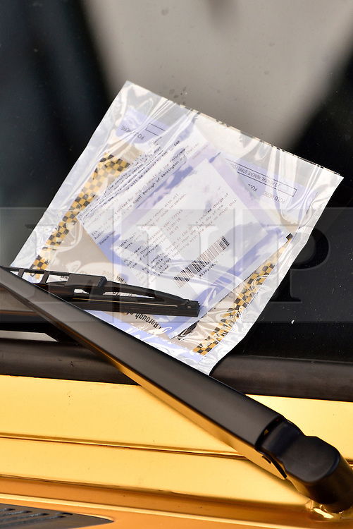 © Licensed to London News Pictures. 31/03/2016. London, UK. A parking ticket for a£350,000 Bentley covered in gold chrome wrap is parked in Knightsbridge, London on Wednesday, 31 March 2016. Cars are believed to be owned by Saudi billionaire Turki Bin Abdullah .Photo credit: Ray Tang/LNP