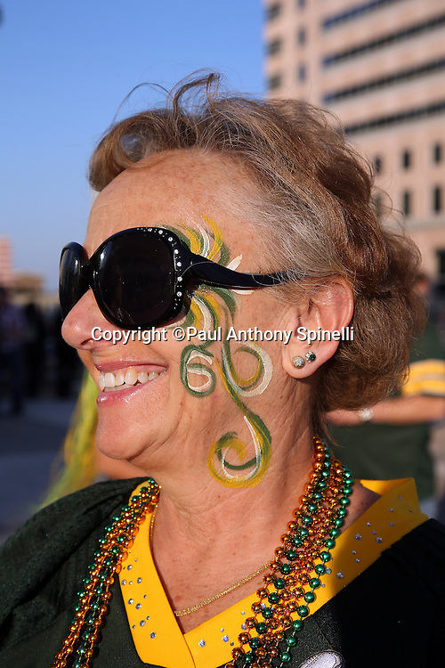 A Green Bay Packers fan shows her team colors on her painted face before the New Orleans Saints NFL week 8 regular season football game against the Green Bay Packers on Sunday, Oct. 26, 2014 in New Orleans. ©Paul Anthony Spinelli