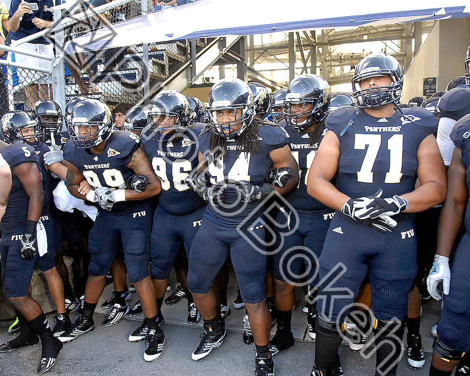 2011 September 17 - The Golden Panthers wait to run onto the field. Florida International University Golden Panthers defeated the Golden Knights of the University of Central Florida, 17-10, at the FIU Football Stadium, Miami, Florida. (Photo by: www.photobokeh.com / Alex J. Hernandez)