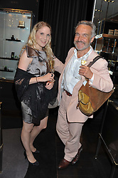SONIA HERSCHTEL and STEPHEN BAYLEY at a private view of jewellery and photographs by Rosie Emerson and Annoushka Ducas entitled Alchemy in association with Ruinart Champagne held at Annoushka, 41 Cadogan gardens, London SW3 on 15th September 2011.