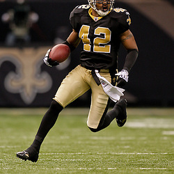 2009 November 30: New Orleans Saints safety Darren Sharper (42) runs with the ball after an interception during a 38-17 win by the New Orleans Saints over the New England Patriots at the Louisiana Superdome in New Orleans, Louisiana.
