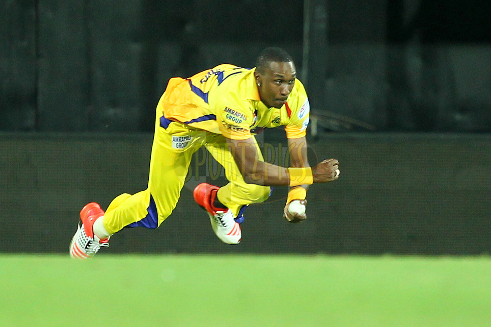 Dwyne Bravo of Chennai Super Kings takes a catch to dismiss Suryakumar Yadav during match 28 of the Pepsi IPL 2015 (Indian Premier League) between The Chennai Superkings and The Kolkata Knight Riders held at the M. A. Chidambaram Stadium, Chennai Stadium in Chennai, India on the 28th April 2015.Photo by:  Prashant Bhoot / SPORTZPICS / IPL