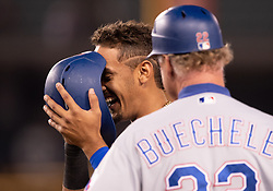 June 12, 2018 - Los Angeles, CA, U.S. - LOS ANGELES, CA - JUNE 12: Texas Rangers first baseman Ronald Guzman (67) laughs with Texas Rangers first base coach Steve Buechele (22) after hitting him with a foul ball during the game between the Texas Rangers and the Los Angeles Dodgers on June 12, 2018, at Dodger Stadium in Los Angeles, CA. (Photo by David Dennis/Icon Sportswire) (Credit Image: © David Dennis/Icon SMI via ZUMA Press)