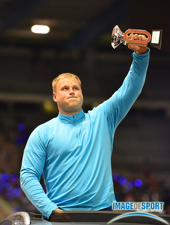 Andrius Gudzius (LIT) poses with the IAAF Diamond League discus champion trophy at  the 42nd Memorial Van Damme  at King Baudouin Stadium in Brussels, Belgium on Friday, September 1, 2017. (Jiro Mochizuki/Image of Sport)