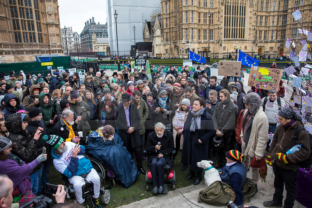 © Licensed to London News Pictures. 23/02/2018. London, UK. Labour MP Paul Flynn (C) speaks to campaigners in support of the use of cannabis at a protest opposite Parliament as MPs debate its use in The House of Commons. Photo credit: Rob Pinney/LNP