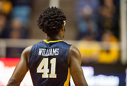 Feb 22, 2016; Morgantown, WV, USA; West Virginia Mountaineers forward Devin Williams (41) walks down the floor during the first half against the Iowa State Cyclones at the WVU Coliseum. Mandatory Credit: Ben Queen-USA TODAY Sports