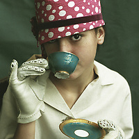 A young woman drinking tea