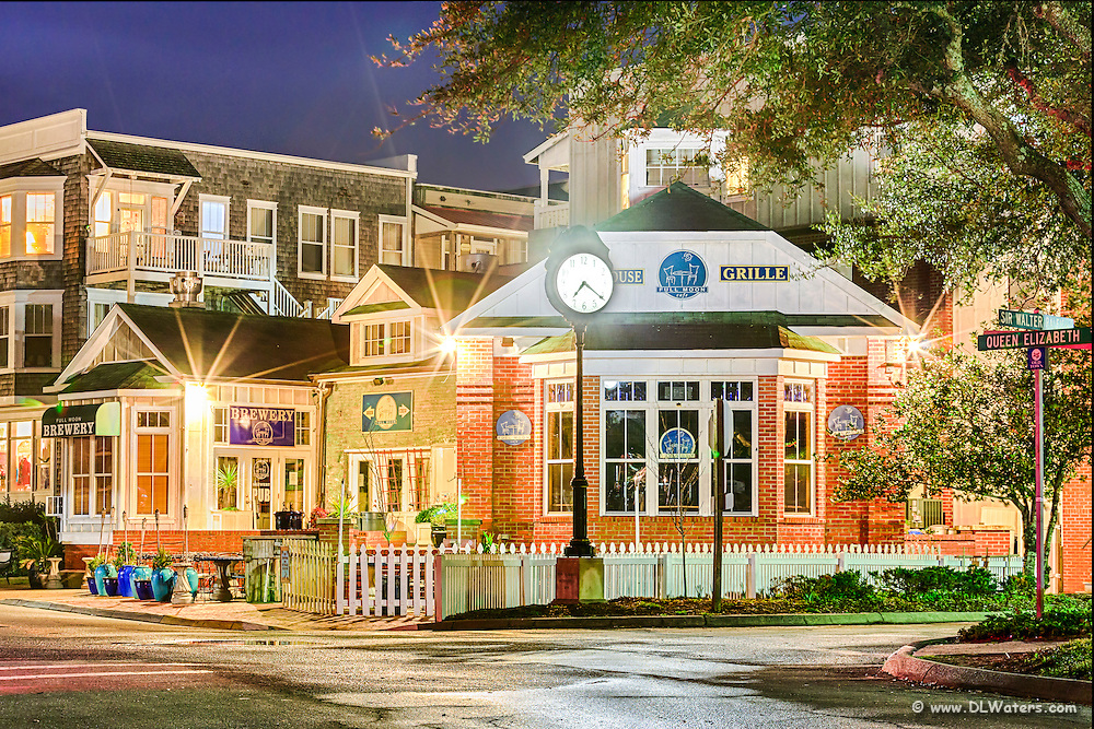 A night photo of the corner of Oueen Elizabeth and Sir Walter Raleigh Streets in Manteo NC.