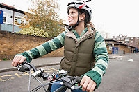 Young woman riding bicycle on street