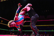 Cassandro (left) is thrown to the mat by Pirata Morgan (right) in the main event during Lucha VaVoom Halloween Ring of Terror at the Mayan Theater on Wednesday, October 26, 2011 in downtown Los Angeles, Calif.  Michael Yanow