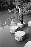 Peter Townsend in a Japanese pond during the filming of his trip around the world.<br />