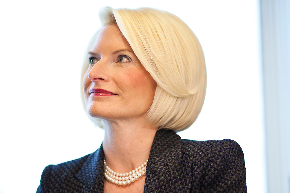 Callista Gingrich, wife of Republican presidential candidate Newt Gingrich, listens as her husband speaks at a Rotary Club meeting on Tuesday, December 27, 2011 in Dubuque, IA.