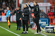 Forest Green Rovers head coach, Mark Cooper and Forest Green Rovers Matt Mills(5) during the EFL Sky Bet League 2 match between Cheltenham Town and Forest Green Rovers at Jonny Rocks Stadium, Cheltenham, England on 2 November 2019.