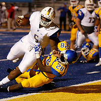 Oxford's Jeremiah Peguess reaches the ball into the endzone past Tupelo's Jake Morris for the two-point conversion during Friday night's game at Tupelo.
