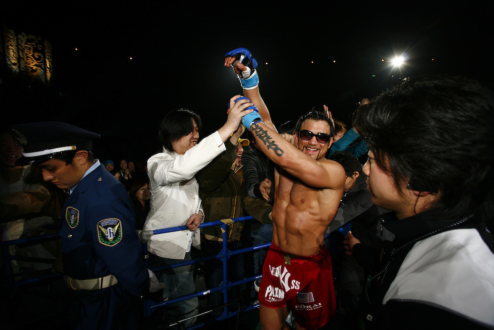 American  Fighter  Phil Baroni after ihis  victory over  Yuki  Kondo ..BUSHIDO Extreme Martial Art fighting Rules are quite limited and fights usually carry on past the bloody nose stage.  It's  very popular in Japan, goes out on primetime TV, fighters get paid as much as 4 million US Dollars a fight and are seen as celebs. Crowd consist of young families, couples etc. Piece will look at why sport is so successful in Japan, appealing to so called 'lost generation' of young people suffering from effects of collapse of economy/rise of unemployment.