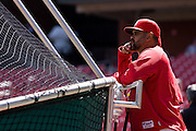 17 April 2010: St. Louis Cardinals Third Base Coach Jose Oquendo watches as St. Louis Cardinals center fielder Colby Rasmus take pitches during batting practice prior to the Cardinals game against the New York Mets at  Busch Stadium in St. Louis, Missouri..
