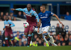 Angelo Ogbonna of West Ham United (L) and Richarlison of Everton in action - Mandatory by-line: Jack Phillips/JMP - 19/10/2019 - FOOTBALL - Goodison Park - Liverpool, England - Everton v West Ham United - English Premier League