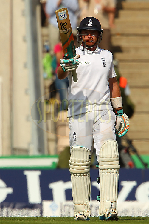 Ian Bell of England raises his bat to celebrate reaching 150 runs during day two of the third Investec Test Match between England and India held at The Ageas Bowl cricket ground in Southampton, England on the 28th July 2014<br /> <br /> Photo by Ron Gaunt / SPORTZPICS/ BCCI